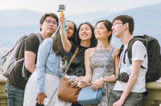 Asian teens taking pictures
