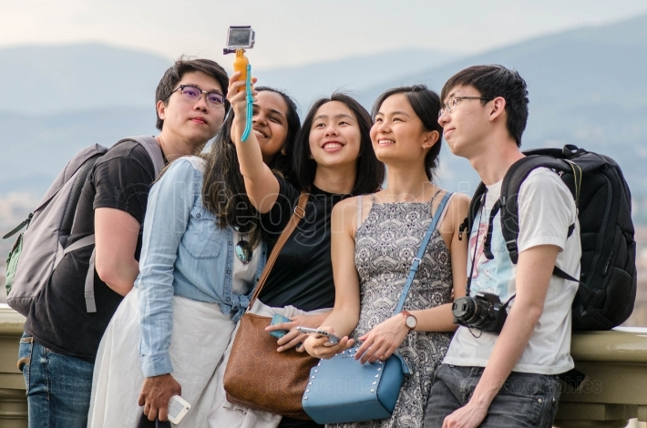 Asian teens taking pictures and selfies