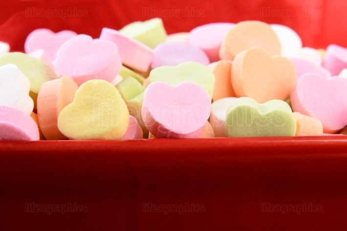 Assorted Candy Hearts in Red Candy Bowl