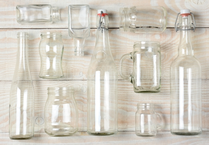 Assorted Clear Glass Bottles on White Wood