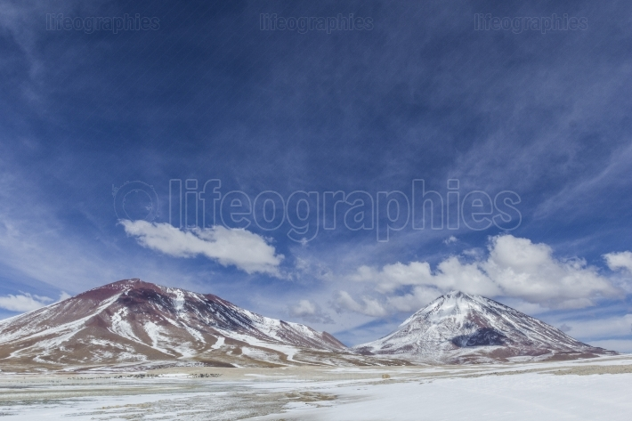 Atacama desert, bolivia with majestic colored mountains and blue