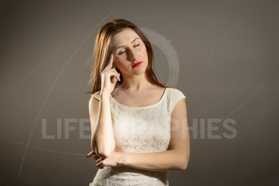 Attractive Business Woman Under Pressure of Work