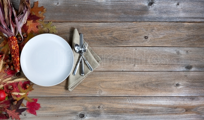 Autumn background with dinnerware setting for Thanksgiving holid
