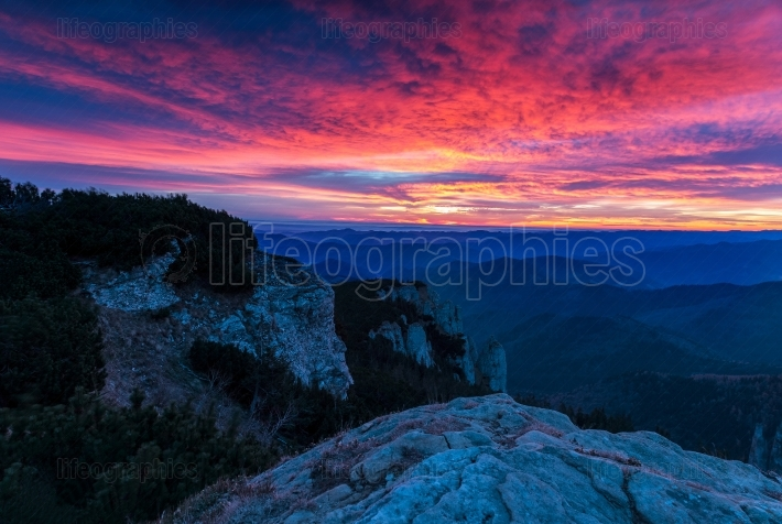 Awesome colorful sunset over the mountain hills