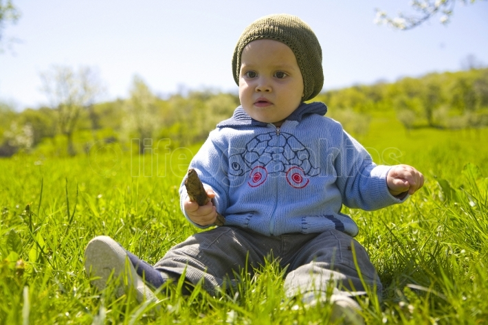 Baby boy playing on grass