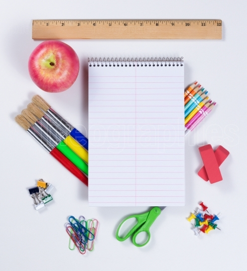 Back to school supplies on white background