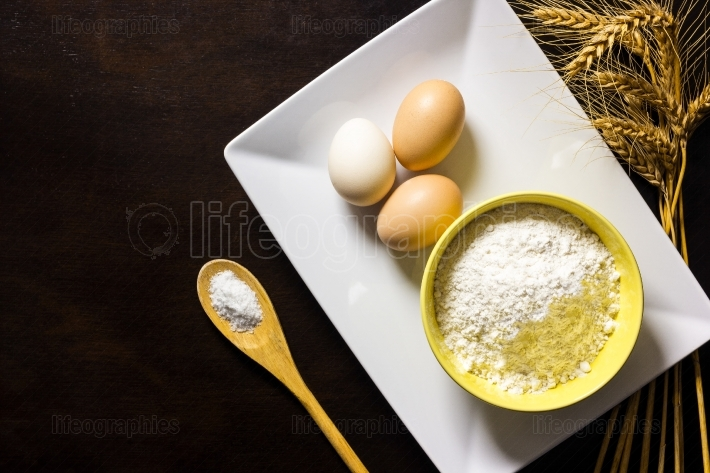 Baking ingredients on wood table background