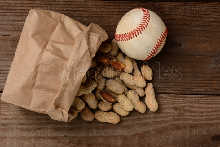 Baseball and a Bag With Peanuts Spilling Out