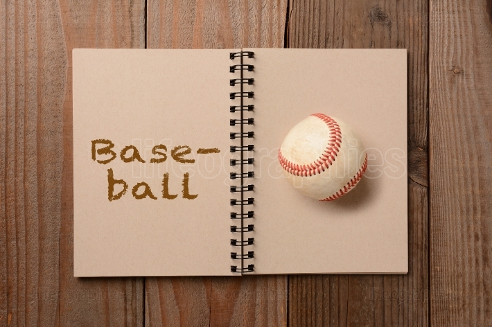 Baseball on Open Notebook