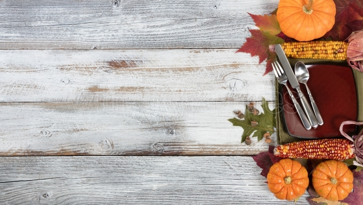 Basic dinner setting with autumn foliage and other fall decorati
