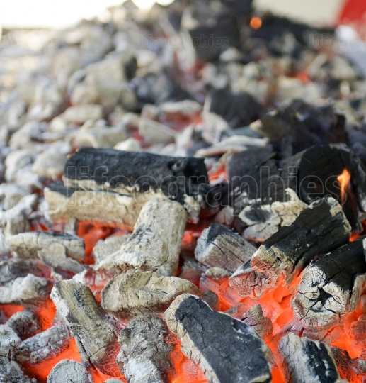 BBQ Grill Pit With Glowing And Flaming Hot Charcoal Briquettes, Food Background Or Texture, Close Up, Top View