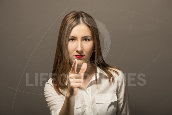 Beautiful business woman point finger at you