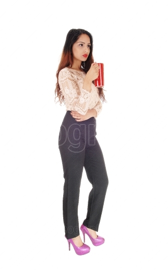 Beautiful businesswoman with red coffee mug