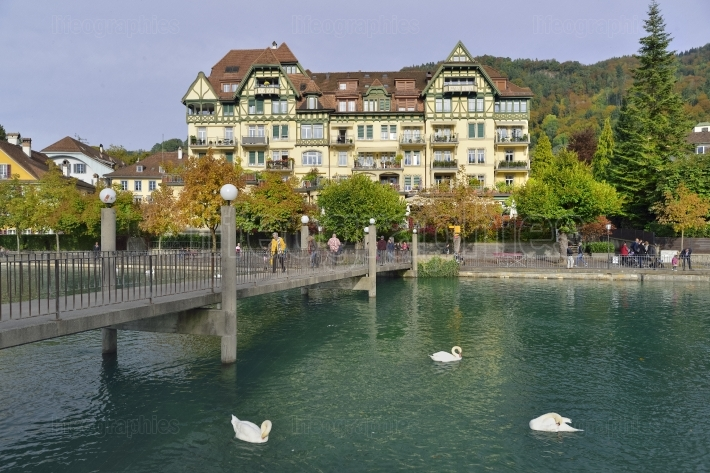 Beautiful coloured autumn landscape with Aare lake and the Alps mountains from in Thun. Switzerland.