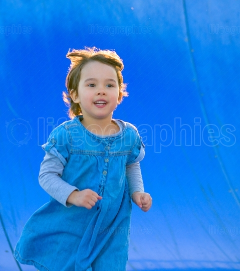 Beautiful girl running in the park