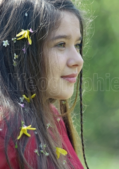 Beautiful girl with flowers in her hair