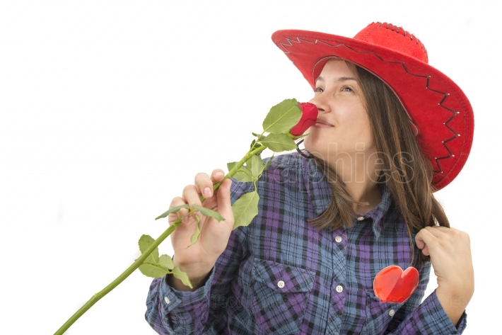 Beautiful girl with rose, heart and red hat