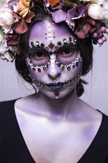 Beautiful Halloween Girl with Rhinestones and Wreath of Flowers