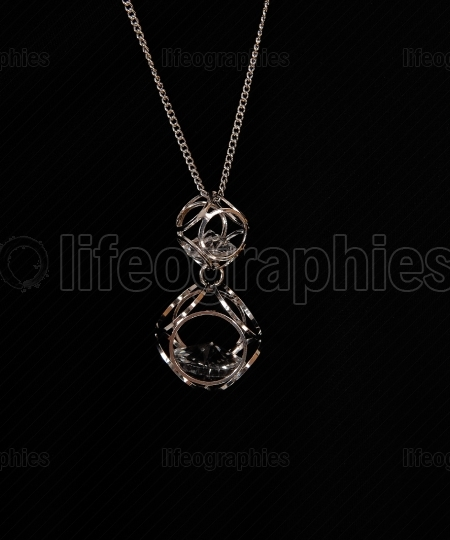 Beautiful necklace over black background