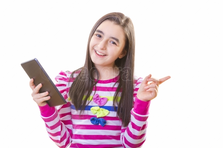 Beautiful teenager girl with digital tablet