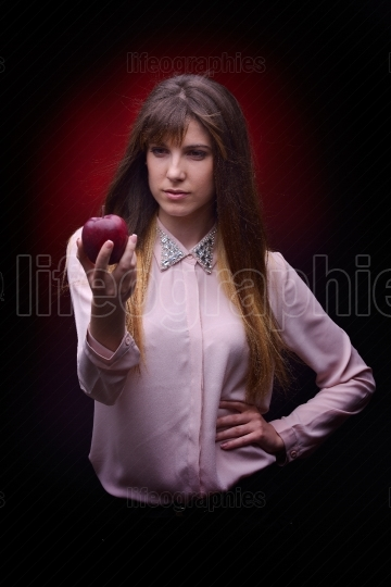 Beautiful woman holding  red apple