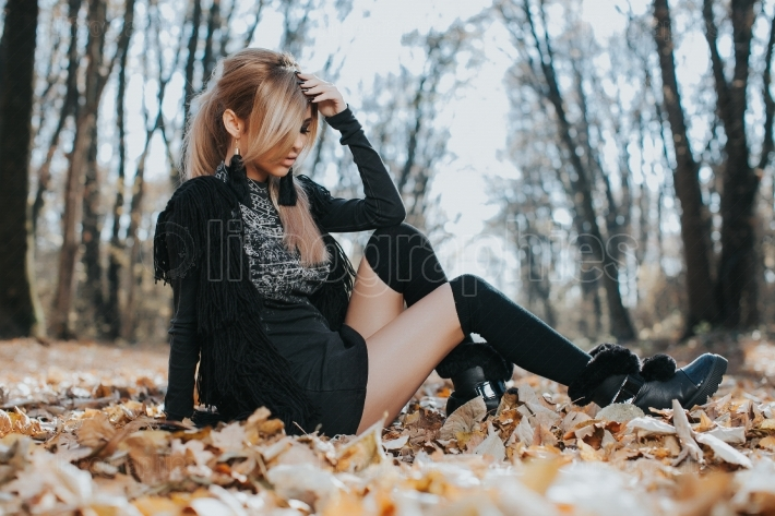 Beautiful woman in leaves