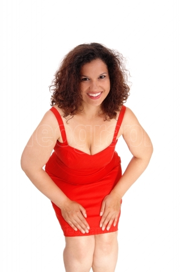Beautiful woman in red dress bending.