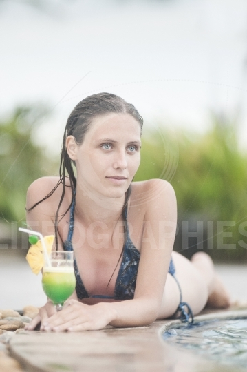 Beautiful woman relaxing in the pool