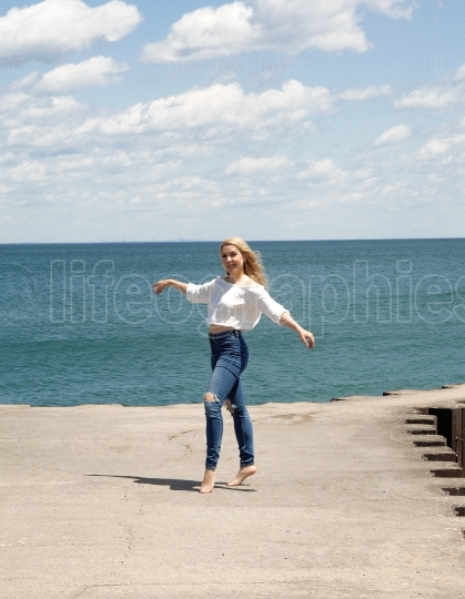 Beautiful woman standing on a pier.