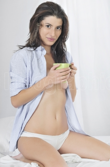 Beautiful woman with a cup of coffee in shirt