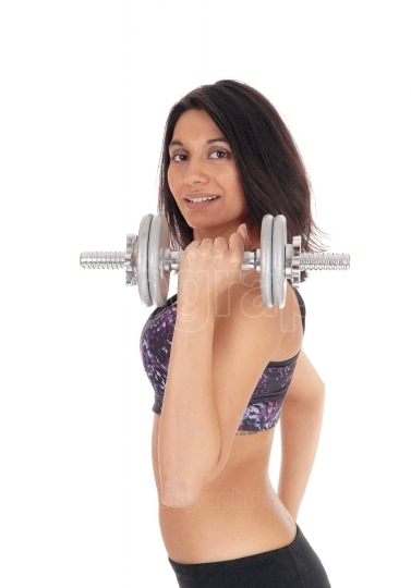 Beautiful woman with dumbbell