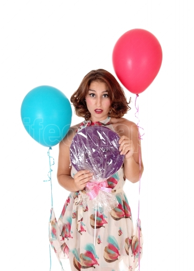 Beautiful woman with lollypop and balloons.