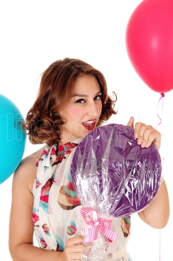 Beautiful woman with lollypop, balloons.