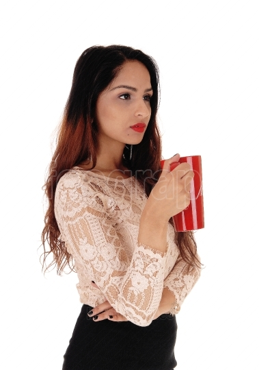 Beautiful woman with red coffee mug