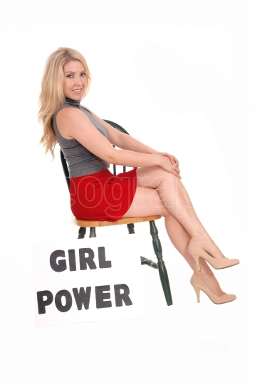 "Beautiful woman with sign ""girl power""."