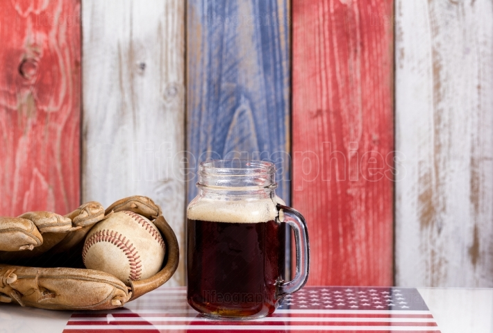 Beer and American Baseball equipment with faded wooden boards pa