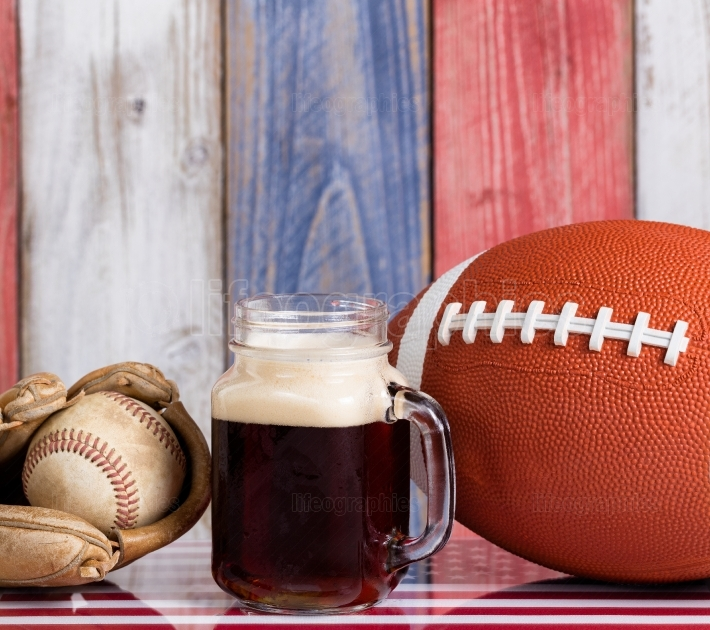 Beer and American sports objects with faded wooden boards painte