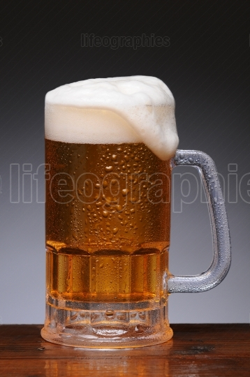 Beer Mug on Wet Wood Surface