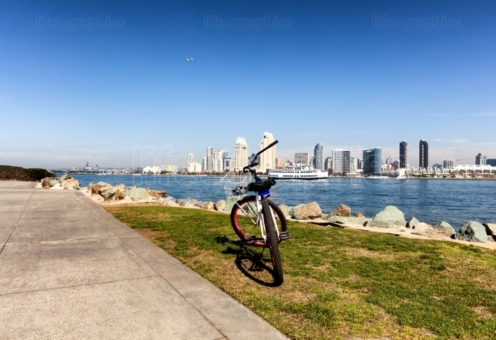 Bicycle with San Diego skyline from the bay