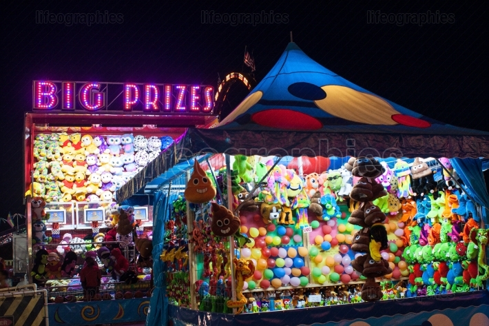 Big Prizes Sign Lit Up At Night In County Fair