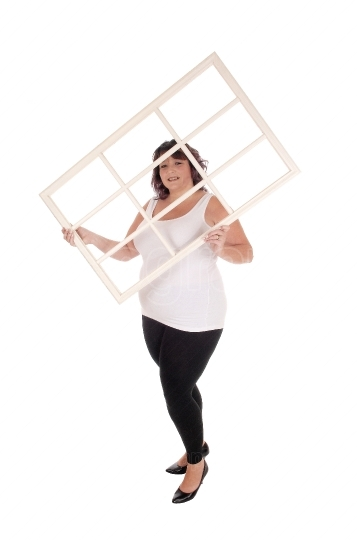 Big woman holding window frame