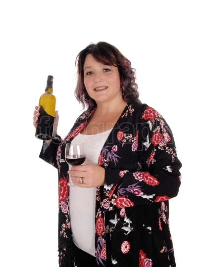 Big woman standing with a bottle wine
