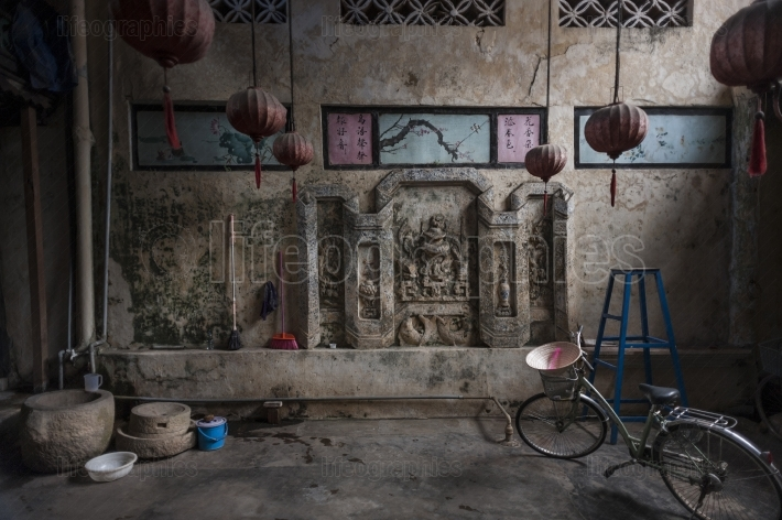 Bike parked inside an ancient house in hoi an village