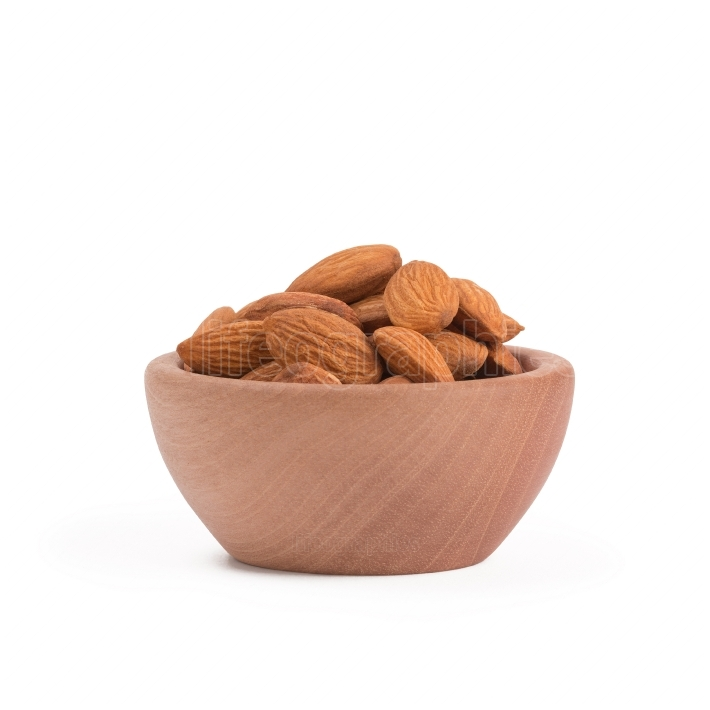 Bio organic almonds in wooden bowl isolated on white background