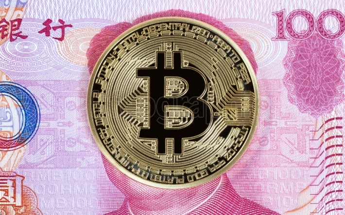 Bitcoin cyber single coin on Chinese paper currency background