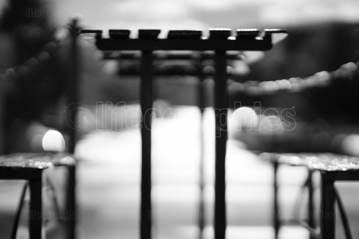 Black and white cafe table with benches bokeh background