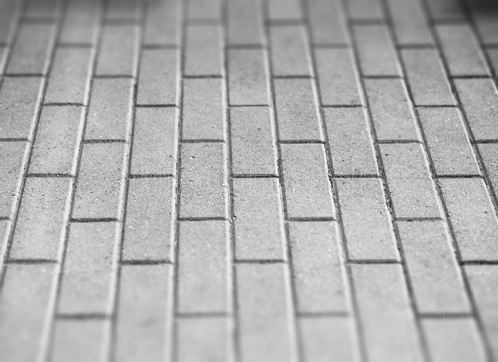 Black and white pavement tiles bokeh background