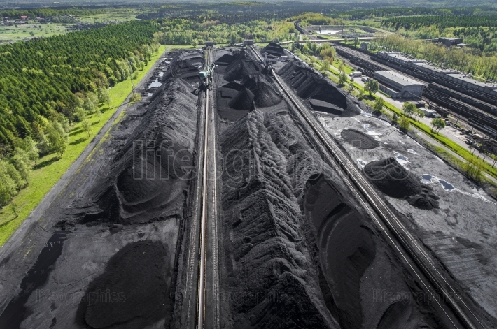 Black coal deposits. exploration and machine. view from above.