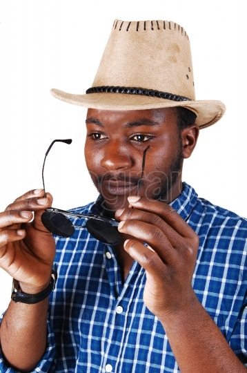 Black man with hat and glasses