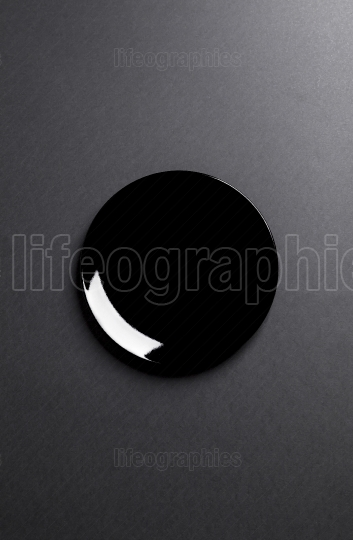 Black plate on black background.Useful as a food background